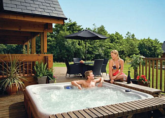 Outdoor hot tub at Tryfan Lodge ( Ref LP4444 ) Holiday Lodges on Isle of Anglesey Wales