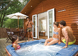 Outdoor hot tub at Cupid Lodge ( Ref LP4117 ) at Bluewood Lodges - Self catering accommodation in Kingham Oxfordshire