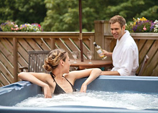 Perranporth Holiday Lodges in Cornwall - Outdoor hot tub at Mill Lodge ( Ref LP3501 ) Leycroft Valley Perrancoombe