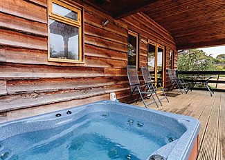 Hot tub at Wimborne Lodge ( Ref LP6319 ) Holiday Lodge at New Forest Holiday Park Cranborne Hampshire England