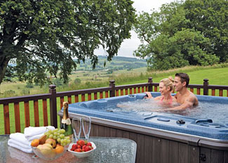 Dumfries Holiday Lodges - Photo of outdoor hot tub at Galloway Hilltop Lodge ( Ref LP6434 ) Nunland Hillside Lodges Dumfries in Scotland