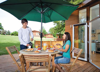 Decking area at typical Tamar Lodge ( Ref LP6474 ) at Ruby Country Holiday Lodges in Halwill Devon England