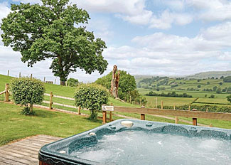 Outdoor hot tub at Bluebell Lodge ( Ref LP3338 ) Lodge at Trewythen Holiday Lodges Powys Wales