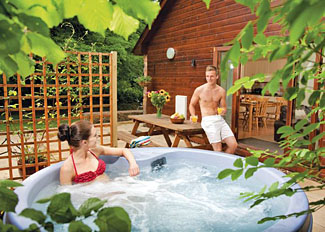 Holiday Lodge with outdoor hot tub at Paddock Lodge ( Ref LP3885 ) Whipcott Water Holiday Lodges in Somerset England
