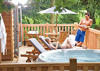 Lovetts Lodge has an outdoor hot tub at Henlle Hall - Holiday Lodges near Oswestry in Shropshire England