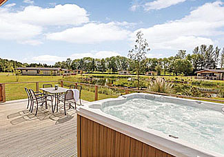 Outdoor hot tub at Daleside Lodge - Cedar Retreats Lodges West Tanfield North Yorkshire ( Lodge Ref LP7305 )
