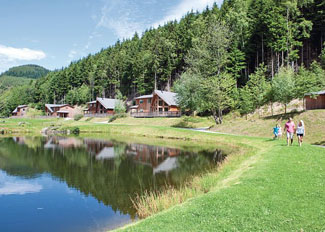 Lakeside setting of holiday lodges near Llangollen Wales - Penvale Lake Lodges sleep up to eight guests
