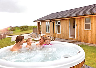 Typical Gwenever Lodge with outdoor hot tub ( Ref LP8921 ) Caddys Corner Holiday Lodges Carnmenellis