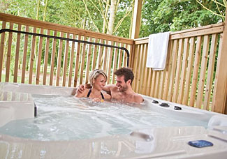 Outdoor hot tub at holiday lodge in Lincolnshire - Belfry Lodge ( Ref LP8695 ) at The Manor Resort near Laceby England