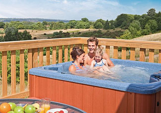 Outdoor hot tub at Bassetts Lodge ( Ref LP8818 ) at Warren Lodges - Lodge accommodation in Essex England