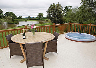 Decked area with sunken outdoor hot tub at Oxmoor Lodge ( Ref LP8037 ) Wigmore Lakes Lodges - Shrewsbury Holiday Lodges in Shropshire England