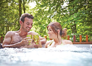 Photo of outdoor hot tub at Deerpark Forest Lodge - Liskeard self catering accommodation in Cornwall England