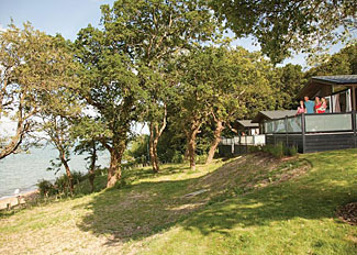 Lodge setting at Woodside Coastal Retreat - Holiday Lodges at Wootton Isle of Wight England