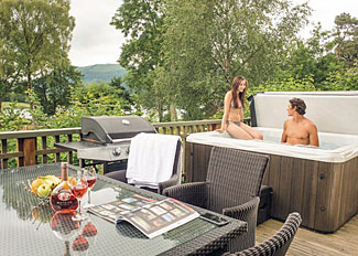 Outdoor hot tub at Lakeland Lodge Plus ( Ref LP7486 ) - Self catering accommodation near Keswick Cumbria - Holiday Lodge at Bassenthwaite Lakeside