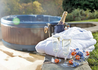 Champagne and outdoor hot tub at Ivy Tree Lodge ( Ref LP11434 ) Slate House Powys Holiday Lodges in Wales UK
