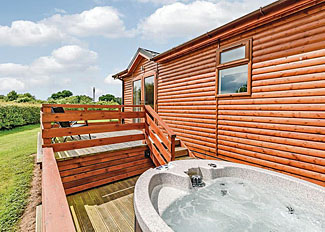 Verandah with outdoor hot tub at Chestnut Lodge ( Ref LP5780 ) at Beaconsfield Park - Shropshire Holiday Lodges in England