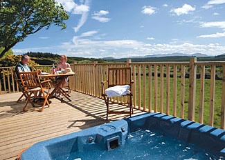 Decking and outdoor hot tub at Thanet Well Holiday Lodge near Penrith England