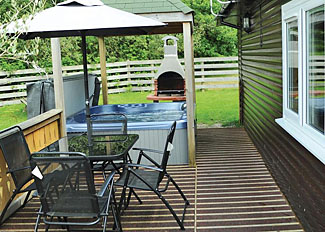 Typical decking and outdoor hot tub at Red Kite VIP Lodge ( Ref LP3385 ) Heronstone Holiday Lodges Powys Wales