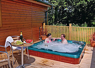 Cullompton holiday lodges in Devon England - Upton Lakes Lodges - Photo of outdoor hot tub at Lakeside Elm (Pet Friendly) Lodge ( Ref LP6737 )