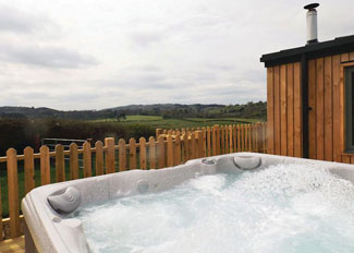 Outdoor hot tub at Arran Lodge ( Ref LP9478 ) Holiday lodges at Castle Pren Powys Wales