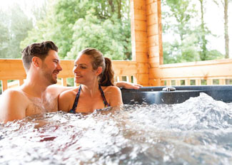 Covered outdoor hot tub at Racing Retreat Lodge ( Ref LP13860 ) - Holiday lodges at Peckmoor Farm near Crewkerne Dorset England