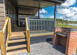 Decking and barbecue area at Lakeside 2 Lodge ( Ref LP12867 ) - Woodhall Country Park - Lincolnshire Holiday Lodges in England