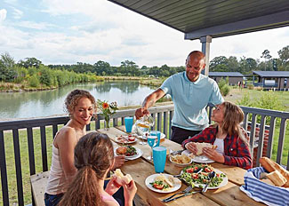 Holiday Lodge decking area at Woodhall Country Park - Lakeside 2 Lodge ( Ref LP12867 ) Holiday Park in Lincolnshire England