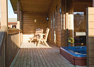 Decking area at Dragonfly Watersedge Lodge ( LP3748 ) Dacre Lakeside Holiday Park near Driffeld Yorkshire England