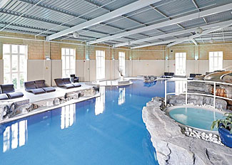 Indoor heated swimming pool at Slaley Hall Lodges in Northumberland England