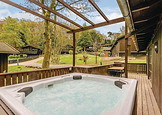 Maple Lodge ( Ref LP5419 ) Hot tub at Brockwood Hall Holiday Lodge Millom near Lake District England