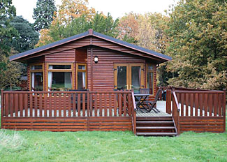 Setting of Woodland Classic 4 Lodge ( Ref LP11254 ) at Fritton Holiday Lodges Norfolk England - Self Catering Lodge Accommodation at Fritton
