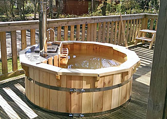 Wood-fired outdoor hot tub at Woodland Premier 3 Spa Lodge ( Ref LP15025 ) at Fritton Lakes Retreats - Holiday Lodges Norfolk England - Self Catering Lodge Accommodation at Fritton
