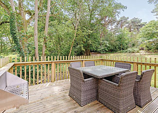 Decking with dining area at Forest Lodge 3 at Burnbake Forest ( Ref LP8961 ) Lodge Accommodation in Dorset