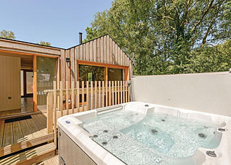 Outdoor hot tub at Forest Lodge 2 ( Ref LP8960 ) Burnbake Forest Holiday Park - Lodge accommodation near Wareham