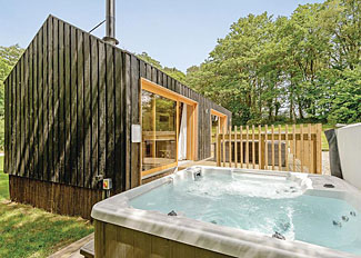 Burnbake Forest Lodges - Decking and hot tub at Forest Lodge 3 Executive ( Ref 12348 ) Accommodation in Wareham Dorset