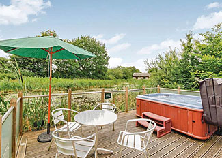 Decking area with hot tub at Bramble Lodge ( Ref LP3908 ) Accommodation at Oakwood Holiday Lodges near York England