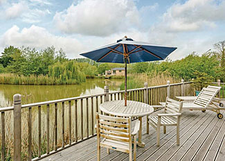 Willow Lodge decking area ( Ref LP4634 ) at Weybread Lakes Suffolk Holiday Lodges in England