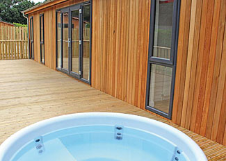 Decking with outdoor hot tub at Pinchbeck Lodge ( Ref LP13983 ) Accommodation at Bainland Lodges - Holiday property in Lincolnshire