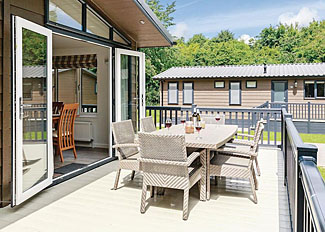 Decking area of Hartfield Watersedge Lodge ( Ref LP9043 ) at Newton Saint Loe holiday lodges in Somerset