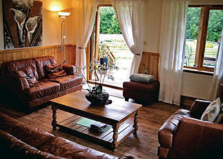 Lounge area in typical Dragonfly Lodge ( Ref LP5295 ) at Oasis Lodges Self catering accommodation at Ledbury Herefordshire England