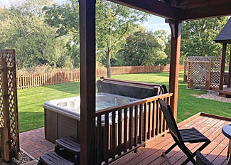 Outdoor hot tub at The Kingsmere Lodge ( Ref LP14753 ) at Old Nene Lodges - Self catering accommodation in Ramsey Cambridgeshire