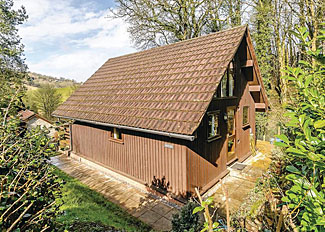 Typical Woodland Lodge ( Ref LP13842 ) Accommodation at Exmoor Gate Holiday Lodges near Wiveliscombe Somerset England