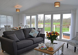 Open plan living area in Hazel Lodge ( Ref LP14782 ) Self Catering Lodge Accommodation at Florence Springs Lakeside Lodges in Pembrokeshire Wales
