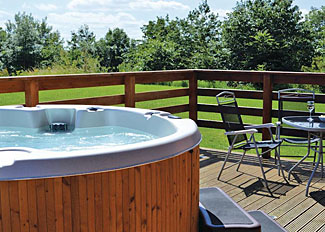 Outdoor hot tub at Grange Lodge VIP ( Ref LP4563 ) Lincolnshire Holiday Lodge in Messingham England - Grange Park Lodges