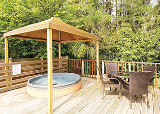 Hot tub and decking at Longnor Wood Deluxe - Holiday Home ( Ref LP7364 ) Buxton Self Catering Accommodation at Longnor Wood Holiday Park Derbyshire England