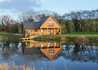 Lakeside Retreat Lodge setting ( Ref LP5569 ) Self Catering Lodge Accommodation in Anglesey Wales