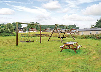 Childrens play park at Caddys Corner holiday lodges near Falmouth Cornwall