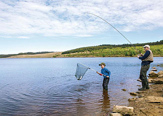 Fishing in Kielder Water in Northumberland England