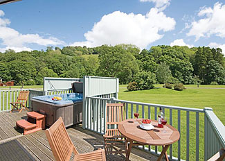 Peel Lodge decking with outdoor hot tub ( Ref LP6820 ) Parmontley Hall Lodges near Hexham in Northumberland