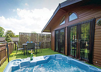 Outdoor hot tub at Larchwood Spa Lodge ( Ref LP3341 ) Holiday Lodges at Raywell Hall Cottingham near Hull Yorkshire